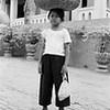 Young bread seller, Phnom Penh, Cambodia 2007