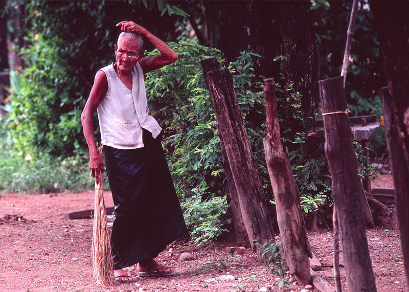 Old Woman Sweeping, Kratie<br /> (Cambodia, 2004)