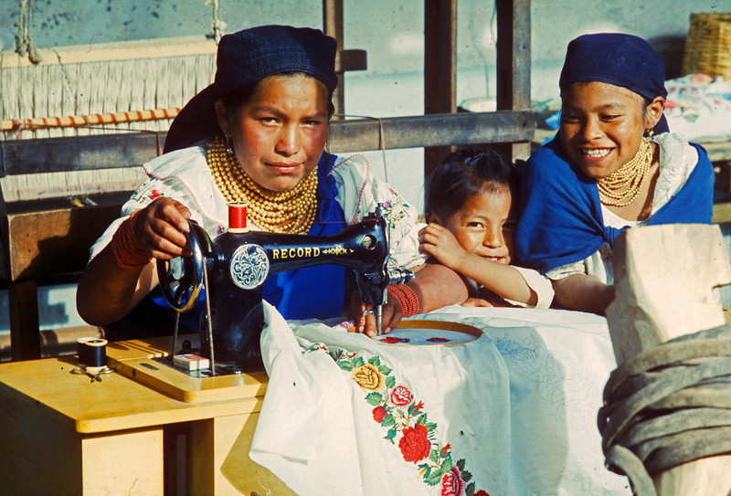 This was Maria and her two children she embroidered blouses for tourists with a treddle sewing machine. His kids were happy he had cold beer in a stream in his yard. I told him to stay home Chicago would be a disapointment.