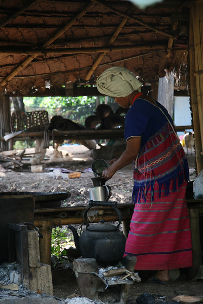 White Karen woman makes us Starbuck's coffee. A friend took us to a white Karen village where the shade grow coffee in the forest for Starbucks. The forest is actually in a national park where these traditional tribes have historic land rights that preceed the park status.