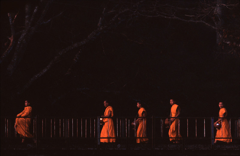 Monks on Bridge at Sunrise, Bonlivan Plateau<br /> (Lao, 2004)