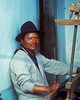 "Segundo- Lived in a small village on a mountainside above Otovalo Ecuador, we rested at his house while hiking in the mts. He wove blankes for sale to tourists in Otovalo. He wanted to come to Chicago and make ""mucho Plata.""  Iasked him why?  He want to make money so he could go shopping like he had seen on TV down at the Hotel in Otovalo."