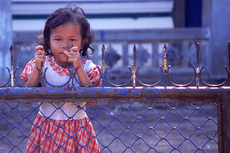 Girl Behind Fence, Siem Reap<br /> (Cambodia, 2004)