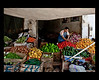 man amongst his produce colours - Fez Medina