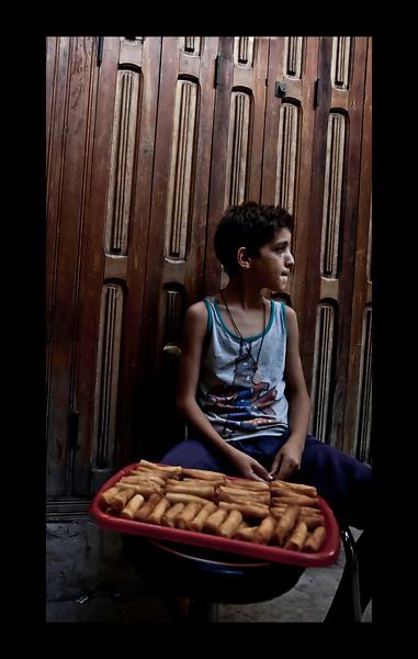 Boy selling pastries - Fez medina