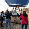 Hot Air Balloon riders take photos before the flight over Perris, California.