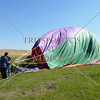 Hot Air Balloon crew prepares to pack balloon after landing on the field in Perris, California.