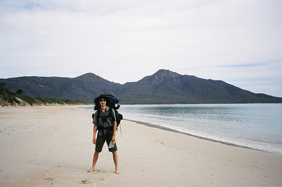 Tobias walking along the beach in Freycinet. Our packs were stuffed to the brim with Christmas pudding and other Christmas goodies.