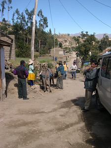 Demitrio starts loading the burros.