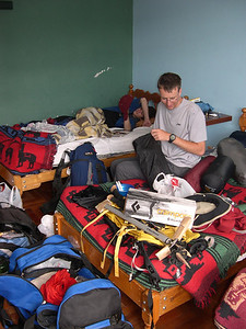 Shane looks over gear.: How bad do I need that ice axe?