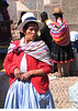 Critical shopper in market of Pisac, Peru