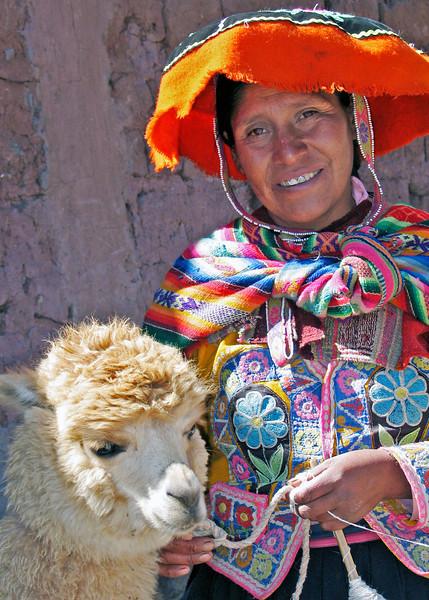 Woman in native dress with lamb in Cuzco, Peru