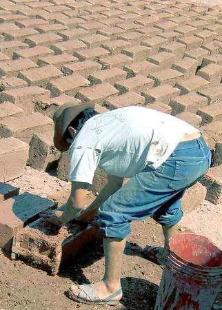 Backbreaking work, making bricks, Pisac, Peru