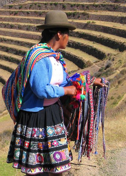 Woman selling belts in Sacsayhuaman, Peru