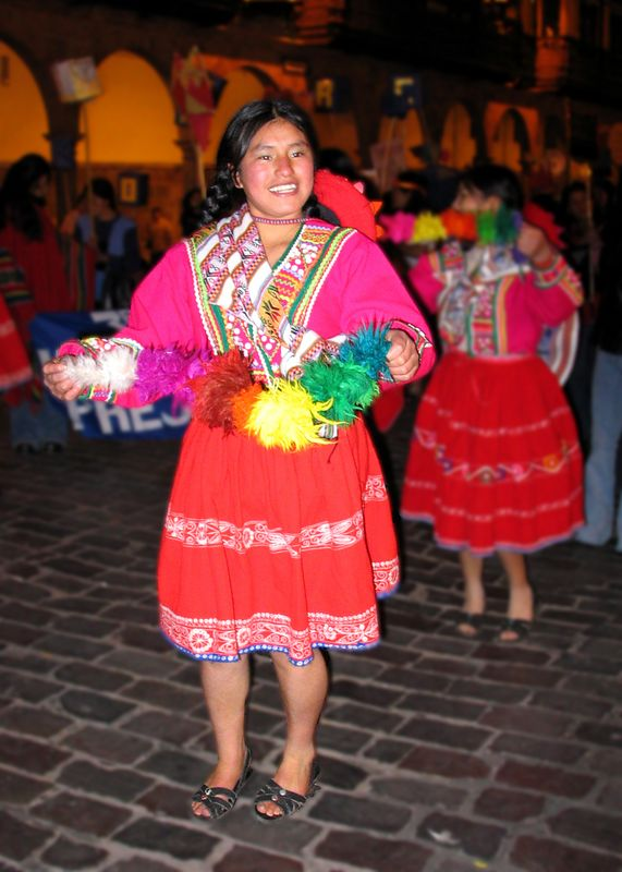 A  happy Cuzco High School dancer at  a parade/competition