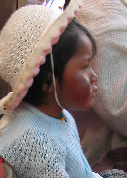 Child at market, Pisac, Peru
