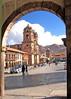 Church in Cuzco, Peru and main square seen through arch