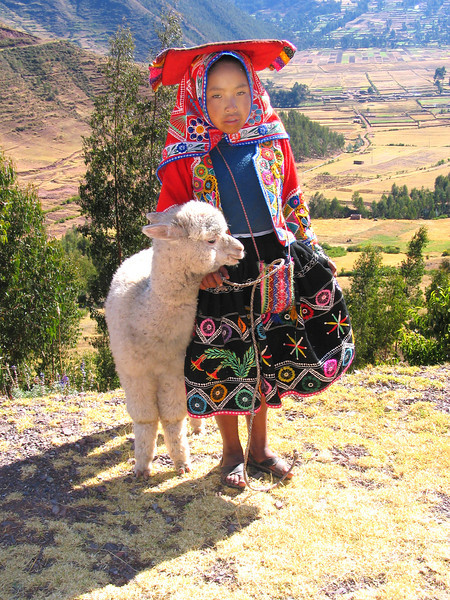 Child in native dress with lamb in Cuzco, Peru