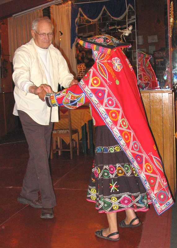 Bill dancing with costumed native in Cuzco restaurant