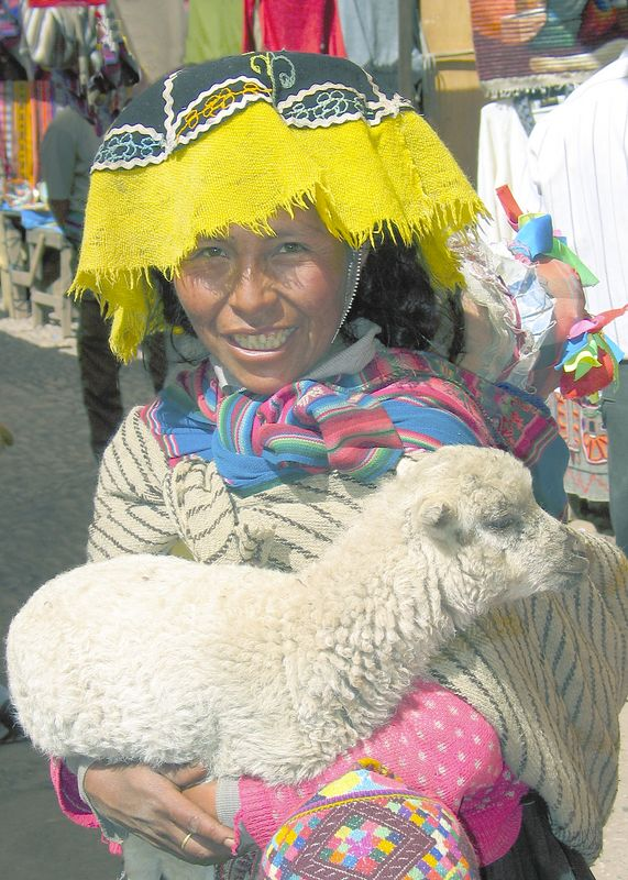Girl with lamb, market in Pisac, Peru