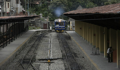 The first train of the day arriving at the train station in Aguas Calientes.