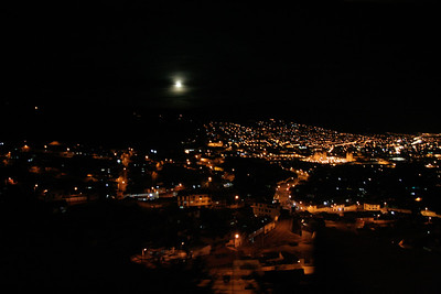 A view of Cuzco at night from the moving train returning from Aguas Calientes. You can see the very well lit church in the Plaza de Armas just to the right of center.