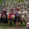 Native Peruvians pose for pictures with their llama and alpacas.