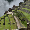 Morning mist rising behind rethatched buildings at Machu Picchu<br /> Wednesday February 9, 2011