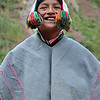 Peruvian boy poses in traditional dress.