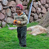 This impish little Peruvian boy was running away with his Mom's ball of yarn.