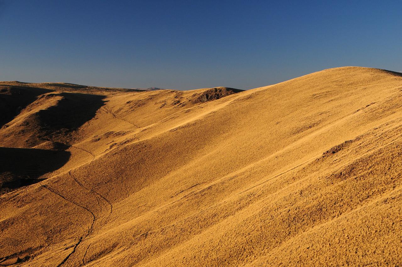 The golden light of sunset along the Santo Tomas - Veille Road. Peru