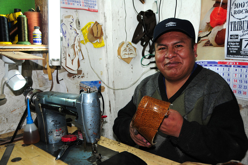 24mm f3.8 1/60th ISO400 D300s.  The guy who DID repair my boots! Cusco, Peru