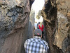 Aaron squeezing through a narrow passage way at an Incan sacred site who's name escapes me.