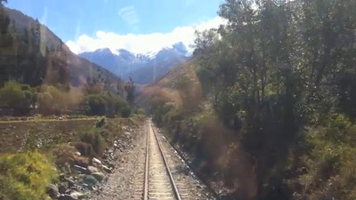 Riding the Peru Rail Vistadome. Spectacular views, food, music, interpretative dances and an alpaca fashion show. The Vistadome has windows in the ceiling to allow people to see the mountains that tower over the tracks.