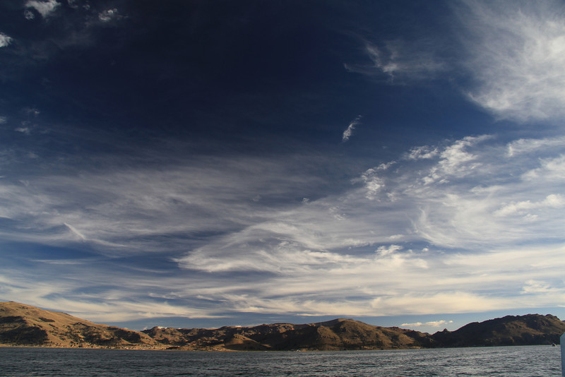 Crazy clouds and hills around Lake Titicaca.