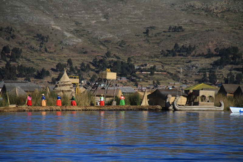 One of the floating islands of Uros, with the inhabitants waiting to greet visitors - each island is inhabited by one family.