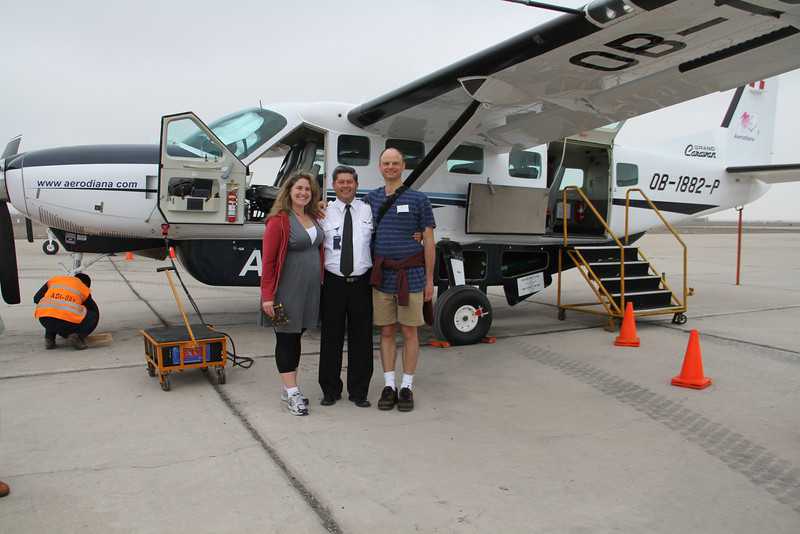 In front of our plane for the flight over the Nazca lines with our pilot  - didn't get his name, doh!