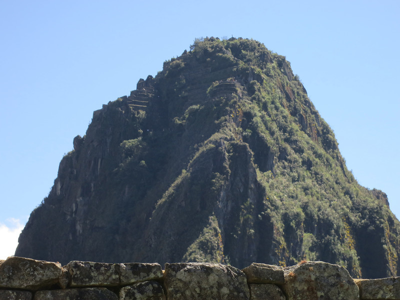 Zoom shot of the peak of Wayna Piccho -  you can see the crazy terracing on the left side as well as in the center, and you can just see people on the various points at the top.