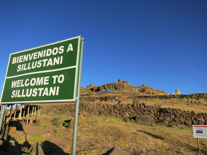 """The Sillustani graves - at around 13,000 ft, and those round structures are actual graves/tombs, called """"chullpas"""". They were built by the Colla people, a pre-incan society that were conquered by the Incans"""