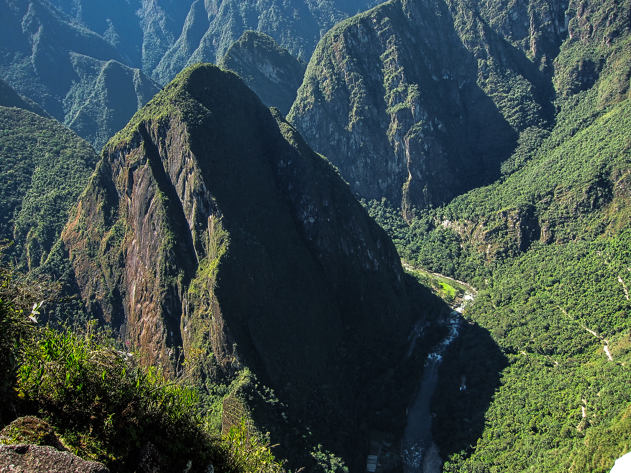 Mount Putuski when viewed from the top of Huayna Picchu. Down at the river is the starting point.