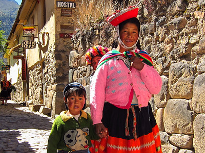 Peruvian family in Ollantaytambo heading towards the festivities.