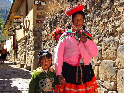 Peruvian family in Ollantaytambo heading towards the festivities.
