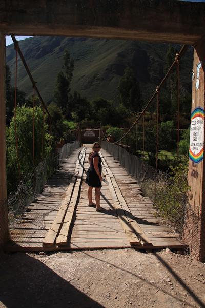 Kay on the bridge across the Rio Urubamba