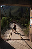 Kay on the bridge across the Rio Urubamba
