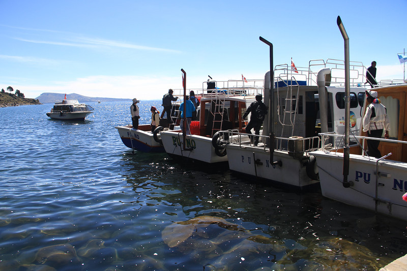 When we pulled up to the island of Taquile, they had a novel docking method - everyone tie onto the previous boat! Would have been fun to watch the one in the middle leave, but we had stairs to climb!