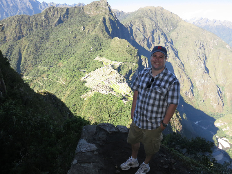 Not the best lighting, but Aaron on a ledge almost at the top of Wayna Picchu - you can see the distance and height over Machu Picchu