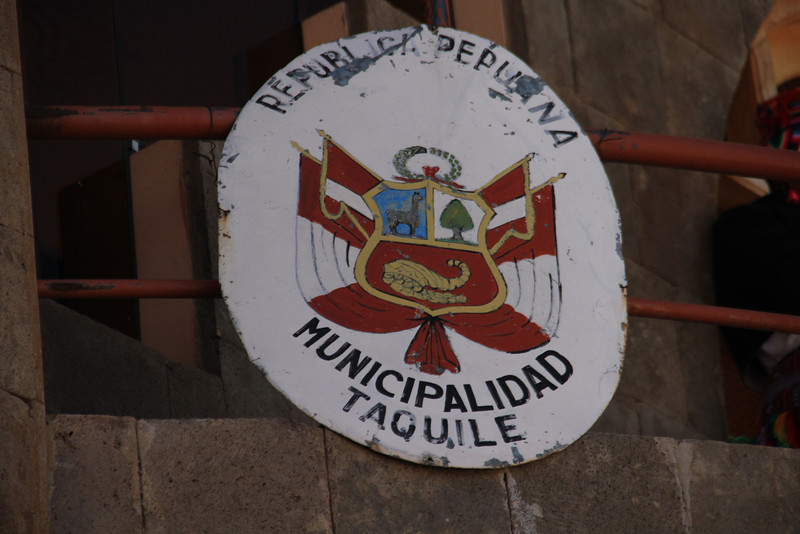 A well worn sign for the municipality of Taquile
