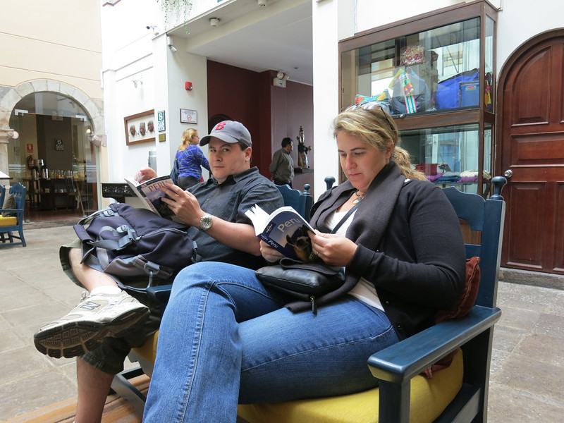 Aaron looks…doubtful. We've got full duelling banjos, err, books here, in the lobby of our hotel in Cusco - trying to figure out what to do on our free day