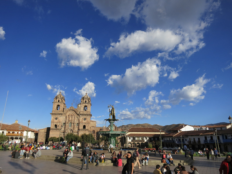 A shot of the Plaza de Armas (central plaza) in Cusco, with the Church of la Compañía de Jesus in the background. (and Starbucks is the wooden frame balcony on the left, with the Starbucks logo just out of the frame on the left, of course)