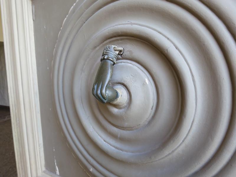 Freakin awesome door knocker on the Pre Columbian museum in Cusco